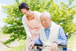 caregiver helping an old man