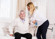 caregiver assisting an old man