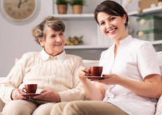 caregiver and her patient drinking a cup of tea